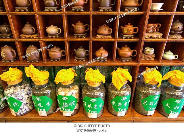 Teapots and jars of loose tea leaves in a tea shop