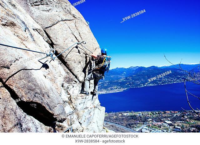 mountaineer along via ferrata, Baveno, Piedmont, Italy, Lake Maggiore