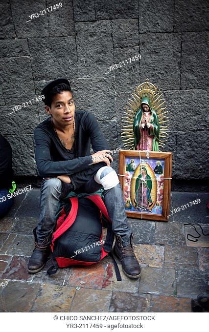 Portrait of a teenage pilgrim at the pilgrimage to Our Lady of Guadalupe Basilica in Mexico City, Mexico, December 10, 2013