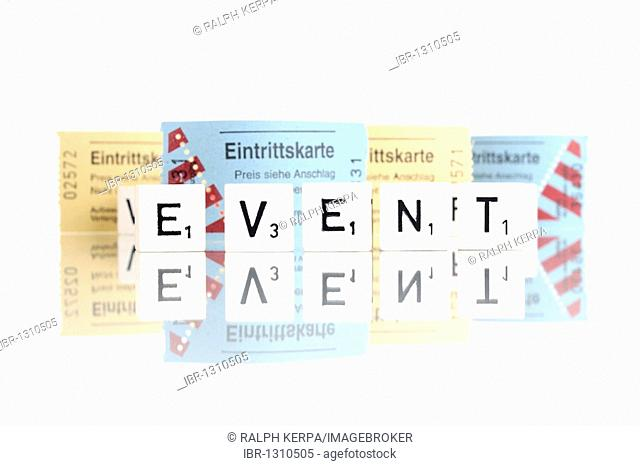 Tickets, dice letters forming the word Event