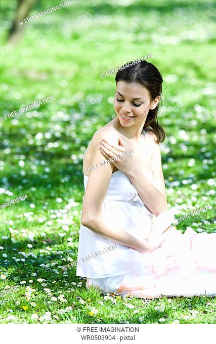 Girl applying cream on her body
