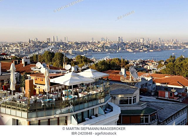 Rooftop terrace of Arden City Hotel in Old City Sultanahmet, Golden Horn, Beyoglu and Beiktas at the rear, Istanbul, Turkey, Europe
