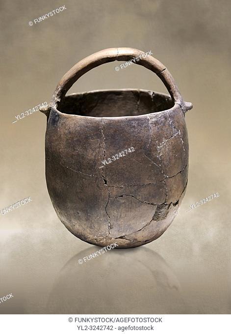 Neolithic terracotta pot with handle. 6000 BC. Catalhoyuk Collections. Museum of Anatolian Civilisations, Ankara