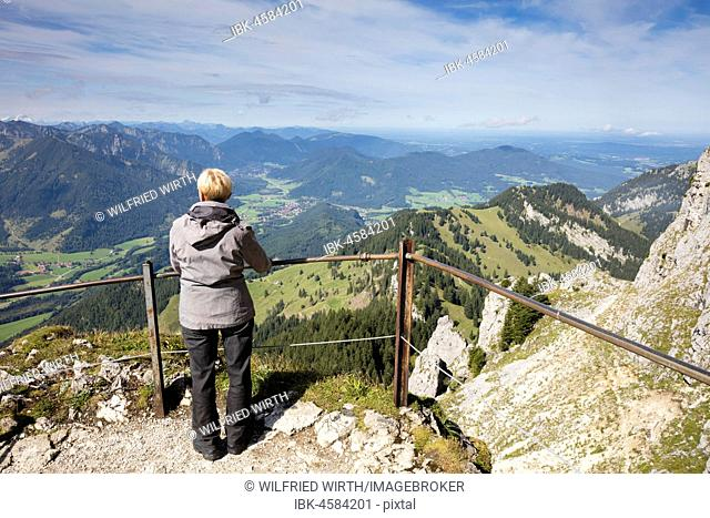 Frau stands at the vantage point at the Wendelstein, Mangfall mountains, Voralpen, Oberbayern, Bavaria, Germany