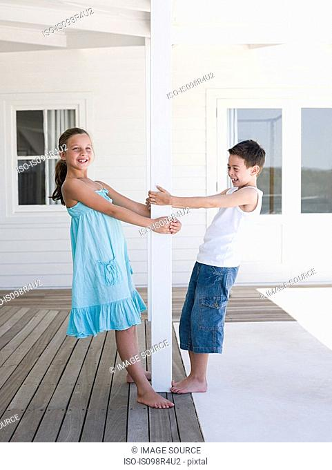 Brother and sister at beach house