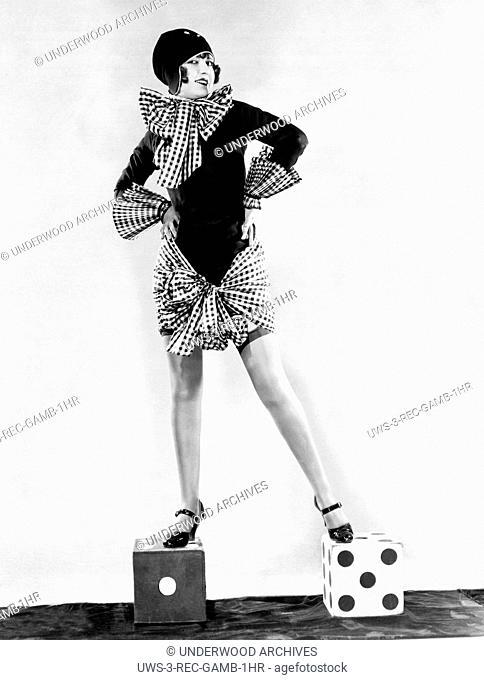 Hollywood, California: c. 1926.Silent fim actress Ethlyne Clair offers advice on the dice