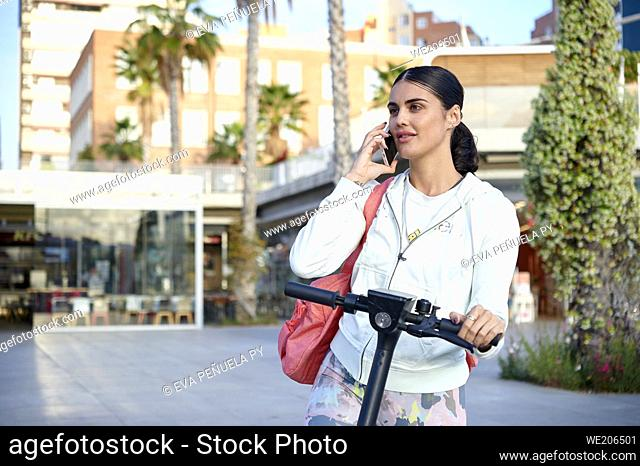 Young woman doing sport outdoors in the city.