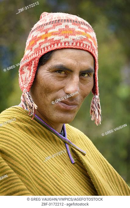 Quechua man of Misminay village wearing traditional woven poncho and knitted ch'ullu hat; Sacred Valley, Peru