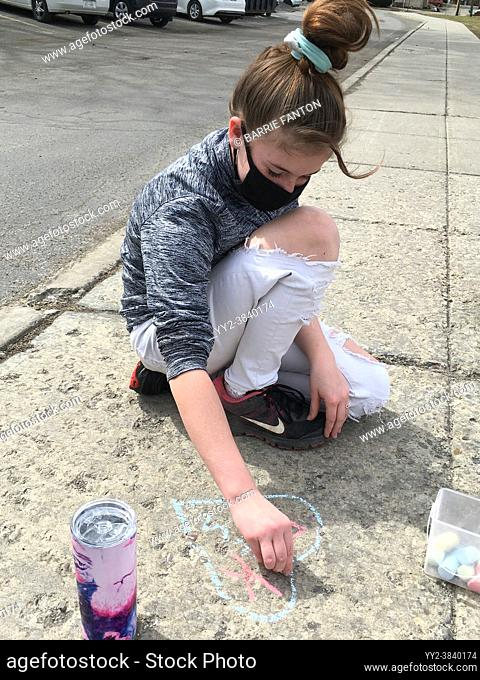 6th Grade Girl Drawing With Sidewalk Chalk, Wellsville, New York, USA