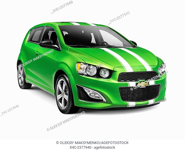 Green 2015 Chevrolet Sonic RS small car isolated on white background with clipping path
