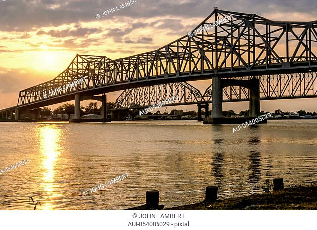 usa, louisiana, new orleans, skyline, crescent city bridge and mississippi river at sunset