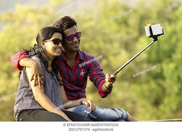Young couple taking a selfie, Lavasa city, Pune, Maharashtra, India