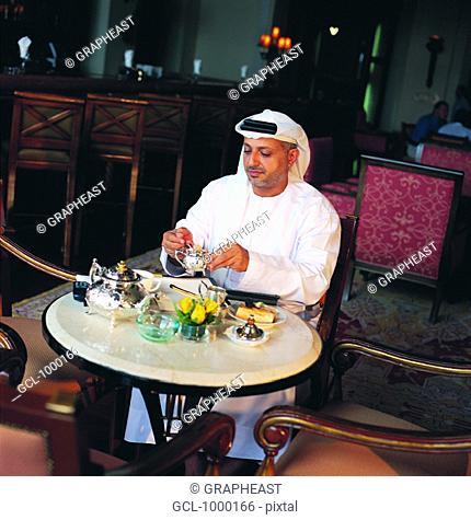 Arab businessman during coffee break