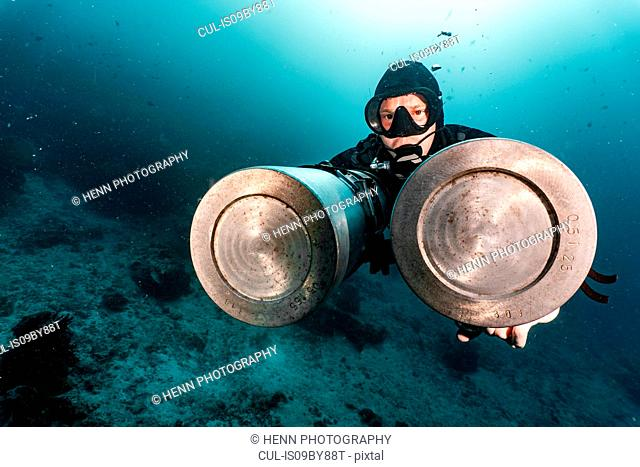 Diver with side mounted air tanks, Raja Ampat, Sorong, Nusa Tenggara Barat, Indonesia