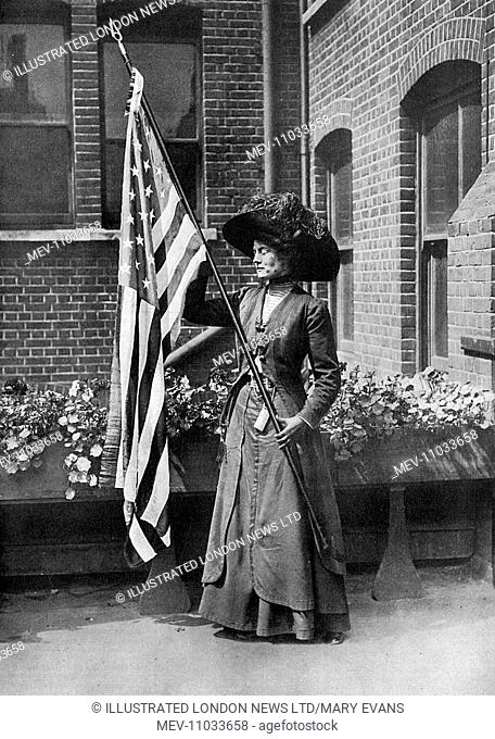 Maud Elliott Roosevelt, niece of ex-President Theodore Roosevelt, pictured holding the star-spangled banner (American stars and stripes flag) which she carried...