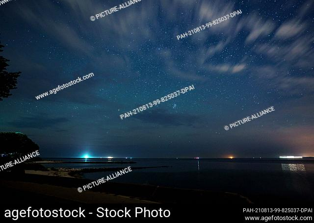 13 August 2021, Schleswig-Holstein, Strande: Countless stars are in the sky above the Baltic Sea. The shooting stars of the Perseids can be seen in the night...