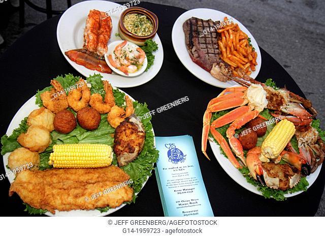 Florida, Miami Beach, Ocean Drive, CJ's, restaurant, food, display, plates, seafood, fish, lobster, crab, steak, surf 'n turf,