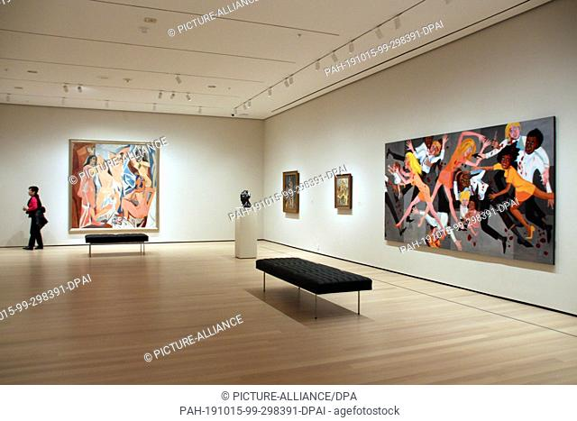 """11 October 2019, US, New York: The paintings """"""""Les Demoiselles d'Avignon"""""""" by Pablo Picasso (l) and """"""""American People Series #20: Die"""""""" by Faith Ringgold hang..."""