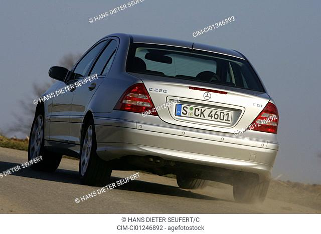 Car, Mercedes C 220 CDI, model year 2005-, silver, medium class, Limousine, driving, diagonal from the back, rear view, country road