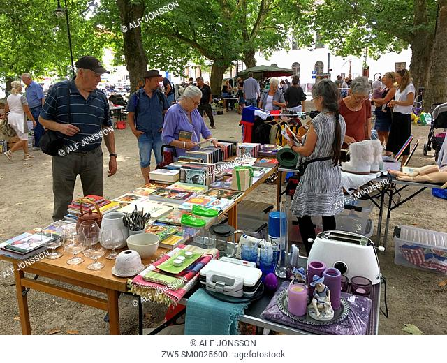 Many people on flea market under platan trees in Ystad, Scania, Sweden