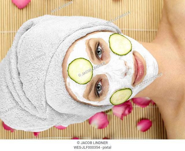 Young woman with face mask at spa, portrait