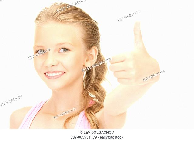 bright picture of lovely girl showing thumbs up sign