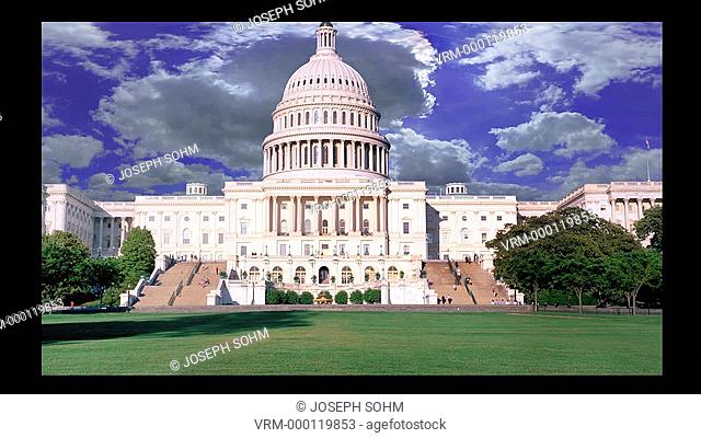White puffy clouds move over US Capitol in Washington D.C. during animated motion graphic sequence