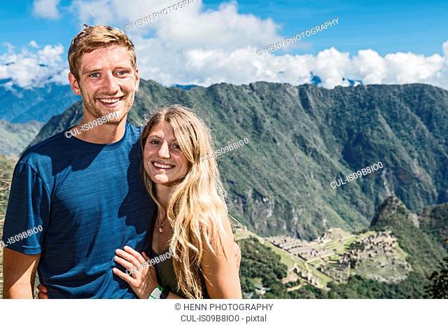 Portrait of couple on the Inca Trail close to Machu Picchu, Cusco, Peru