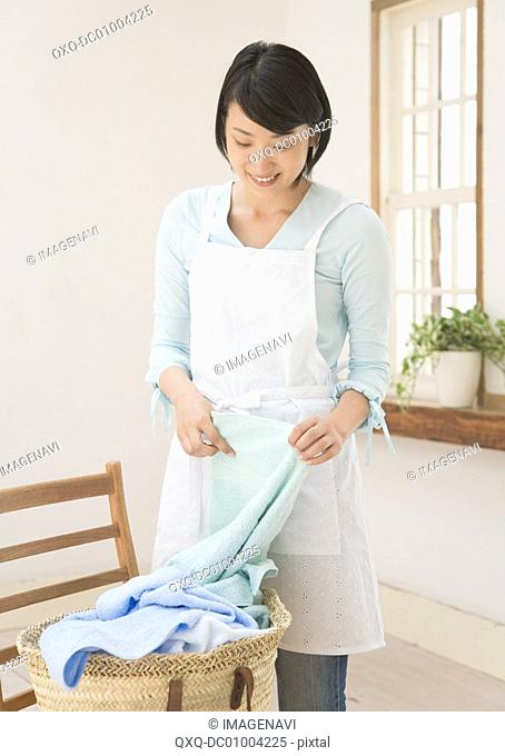 A woman holding laundry