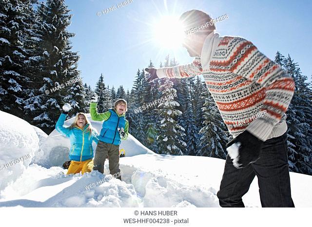 Austria, Salzburg County, Family playing near igloo