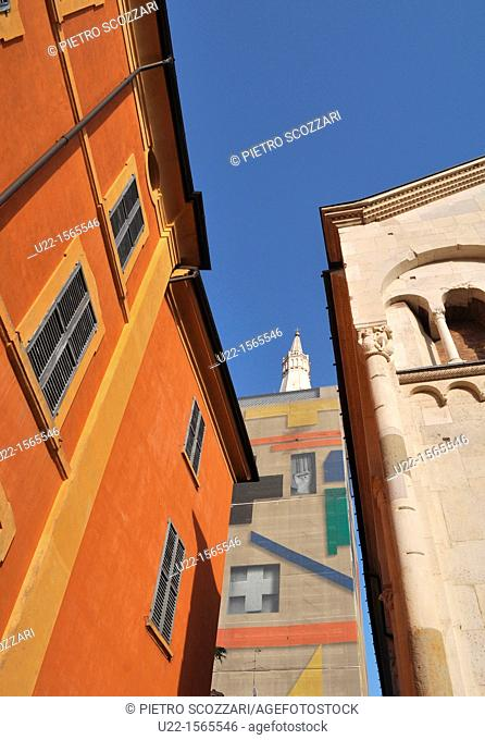 Modena (Italy): part of the Cathedral (right) and its bell-tower, the Ghirlandina, covered during a restoring process