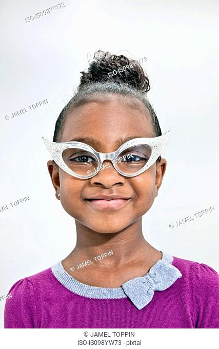 Head and shoulders of girl wearing funny glasses