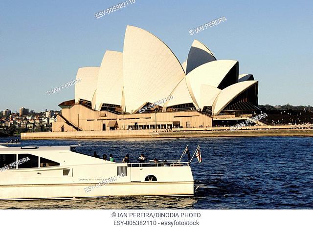 Opera House & boat ; evening shot ; Sydney ; Australia