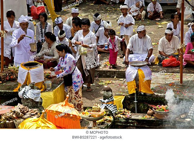 Balinese faithful bring offerings to the Pura Beji in the village of Mas during the Galungan Festival, Indonesia, Bali, Ubud
