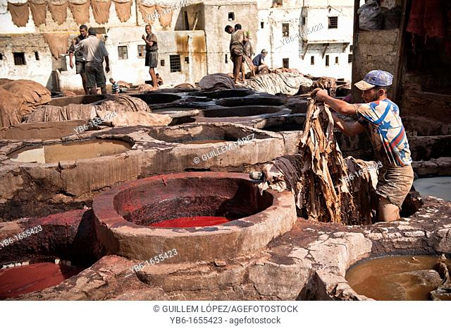 People at work in the Chouwara Leather Tannery of Fez, Morocco