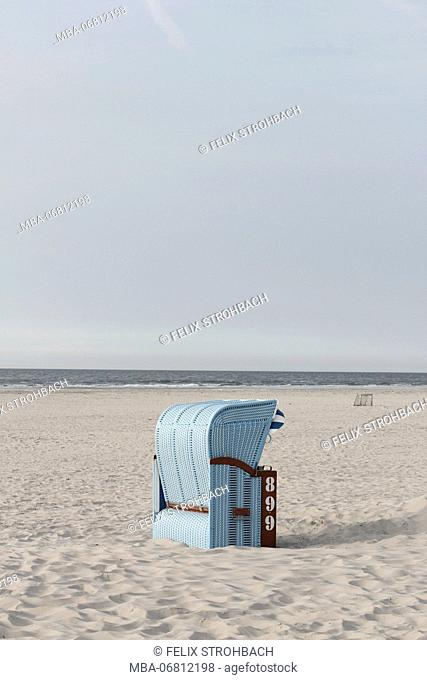 Light blue beach chairs on the island of Juist