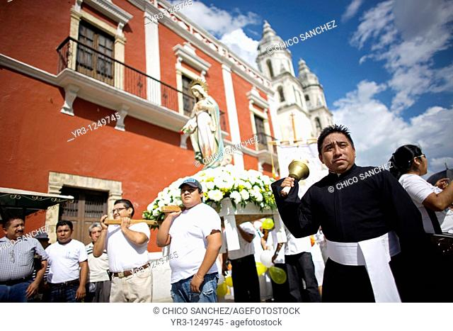 People participate in a Roman Catholic procession at the main square in Campeche on Mexico's Yucatan peninsula