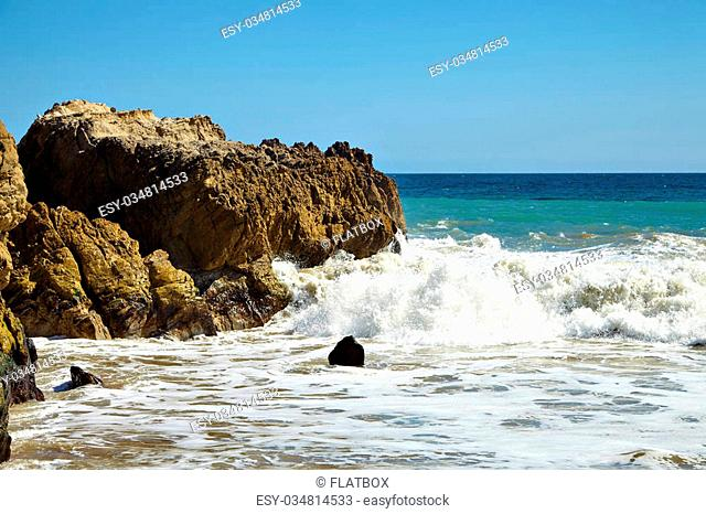 Waves beating against coastal rocks on the cliffs in Malibu California