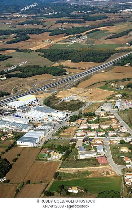 Industry and N-II (Nacional II) road. Riudellots de la Selva, El Gironés, Girona province, Catalonia, Spain