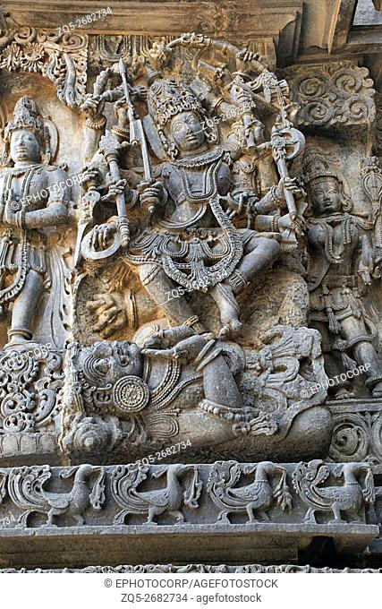 Sculpture of Shiva dancing powerfully on the body of a demon Apasmara (the death), Hoysaleshwara temple, Halebidu, Karnataka, india. view from West