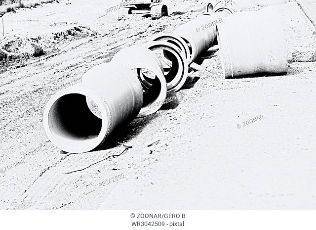 Spun concrete pipe at the construction site white