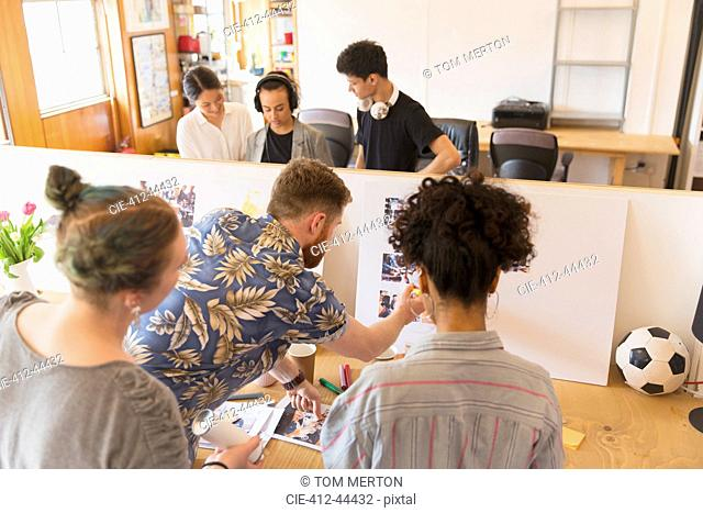 Creative designers reviewing story board in office