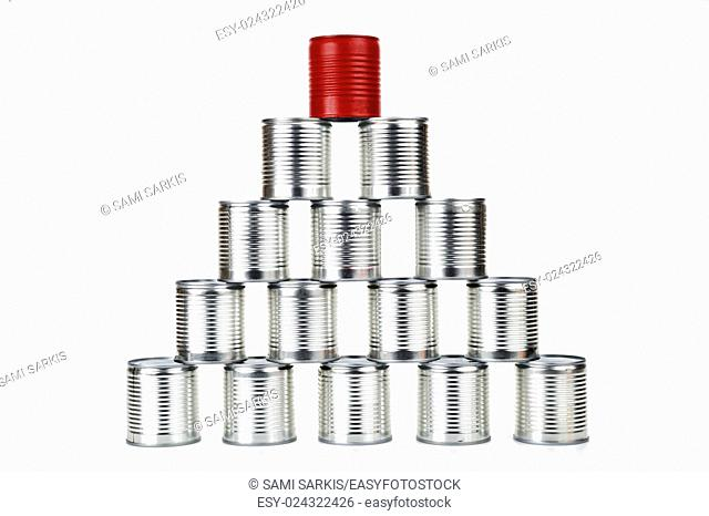 Red tin can on top of a pyramid - difference concept