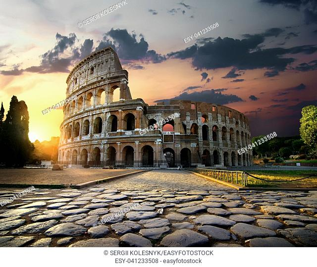 Sunlight on ancient ruins of Colosseum in Rome, Italy