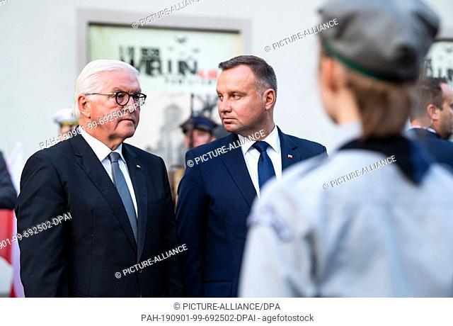 01 September 2019, Poland, Wielun: Federal President Frank-Walter Steinmeier (l) and Polish President Andrzej Duda lay flower arrangements at the memorial of...