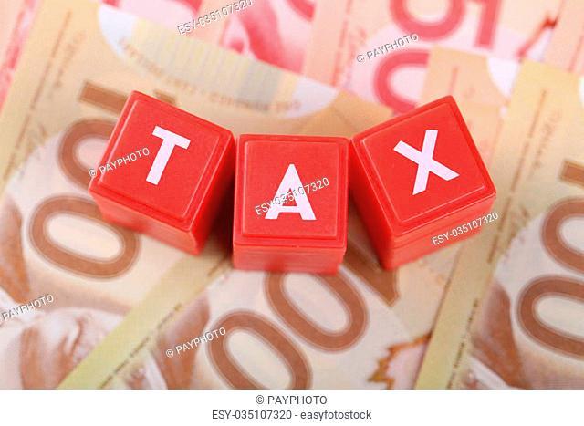 Tax block on money background