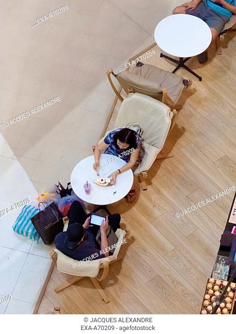 Couple sitting in cafe without communication