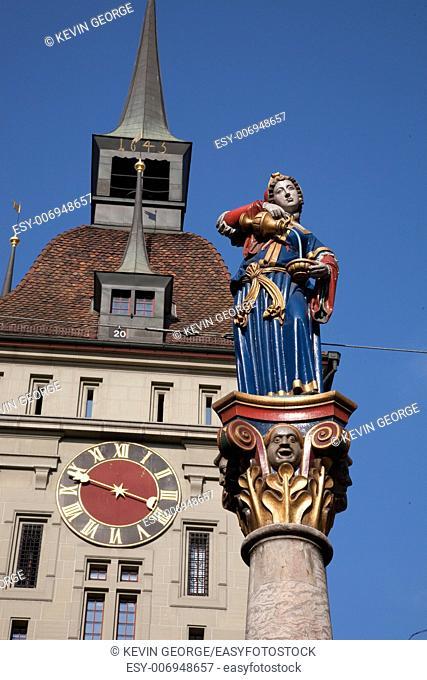 Sculpture of Anna Seiler Brunnen by Gieng 16th Century with Prison Tower; Bern; Switzerland; Europe,