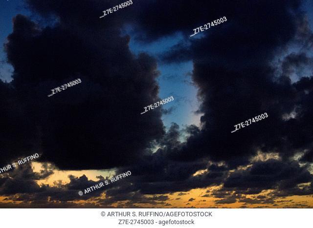 Dark clouds at sunset over Caribbean ocean