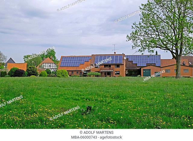 Modern Brick Buildings With Solar Cells Beside A Traditional Half Timbered  House In Hävern,